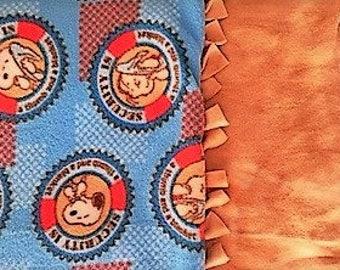 Peanuts Secret Security Blanket! Handmade fleece blanket designed by JAX. A Charlie Brown theme throw shows Lynus & his security blanket!