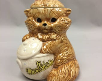 Vintage Naughty Kitty with it's Paw in the Cookie Jar! Made in the USA | Orange Tan Persian Cat with Pink Bow