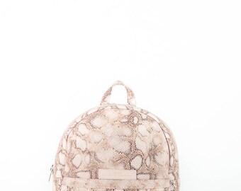 Pink imitation snake leather backpack