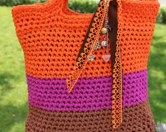 Knitted bag Decorated with lace. Bright orange design
