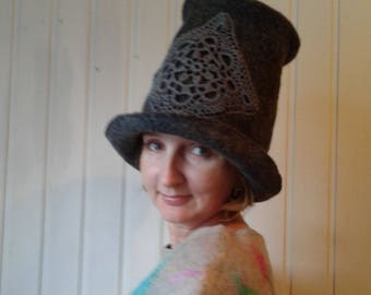 Felt stylish warm hat of gray color with lacy accent for the woman, designer original gray hat in the single copy