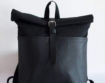 Black eco leather rolltop backpack for cycling