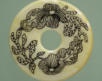 "Pendant design on bone, ""Exotic flowers"""