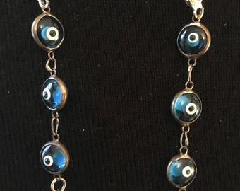 Evil eye and pearl earrings