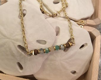 Beaded necklace gold tone