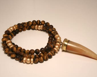 Long beaded tiger eye necklace with tusk horn pendant