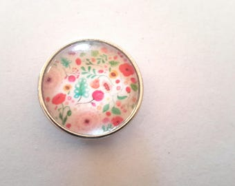snap type floral in shades of pink, red and green glass Cabochon.