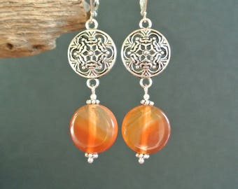 Puck beads round 15 mm agate red-orange color within a shield antique silver tone metal connector earrings