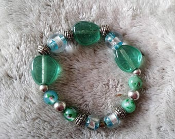 Mint color glass beads bracelet in water