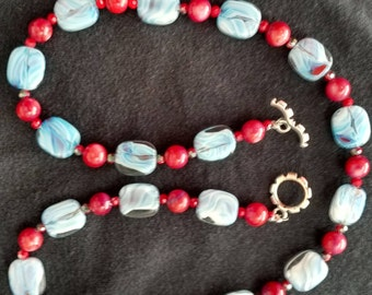 Light blue swirl glass with red beads