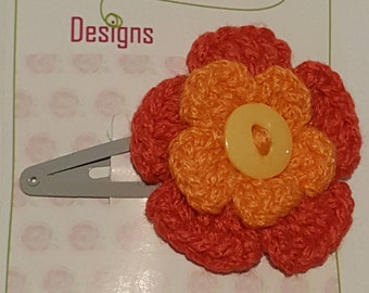orange and red flower hair clip