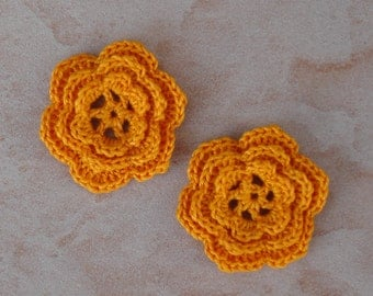 set of 2 6 triple petal flowers orange crochet