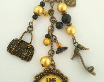 """Key /Bijoux bag yellow and black;"" A MOM in gold """