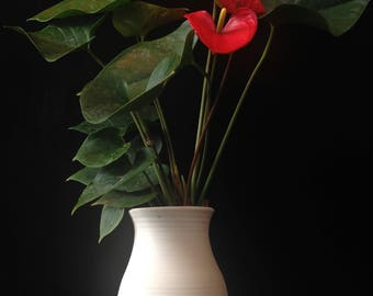 Hand thrown porcelain vessel paired with Lady Jane Anthurium