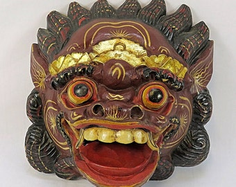 Old wooden mask from Indonesia used for rituals, with Colored details