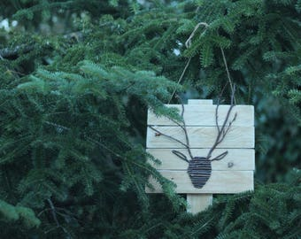 Frame of deer with branches. Recycled, ecological and beneficial