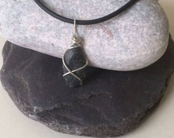 Silver wire wrapped beach stone