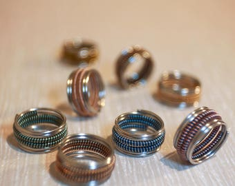 Ring stainless steel spirals of colors