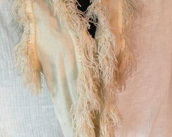 Woven fiber vest with fringe