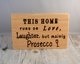 This home runs on Love, Laughter, but mainly Prosecco freestanding sign.