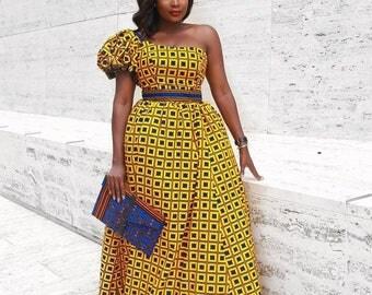 Queen one shoulder dress.