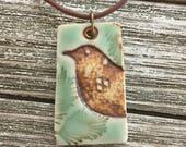 Rustic Bird in the Pines Porcelain Pendant