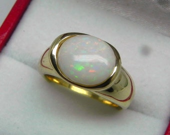 AAA Australian Opal 2.58 carats  11x9mm in 14K or 18K Yellow gold bezel set ring.  0262
