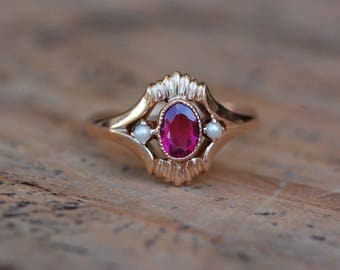 Antique Victorian simulated ruby and seed pearl dress ring in 10K yellow gold