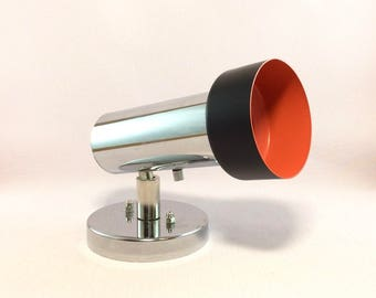 Seventies Raak Amsterdam model A-77 wall spot, ceiling spot in chrome, black and orange.