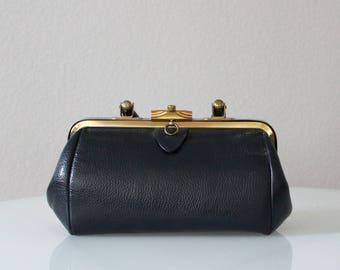 60s handbag. Vintage Saber handbag. Dark blue leather handbag. Ladylike handbag. Structured handbag. Mad Men fashion. Designer handbag