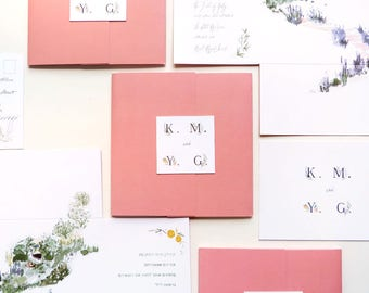Custom wedding invitations; pink, square-fold out, watercolor illustrated, with square clasp for romantic Israeli wedding.