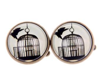 Cufflink cage and bird (1616)