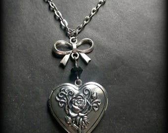 Antique silver heart and rose locket necklace.