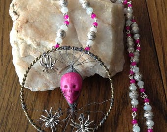 Fuchsia skull with silver-coloured spiders pendant with matching chain