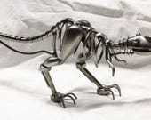 Miniature T-rex dinosaur novelty figurine.  All metal