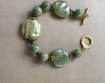 elegant green with gold stiped Kazuri beads