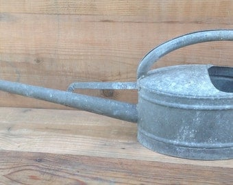 Zinc watering can with very long pourer
