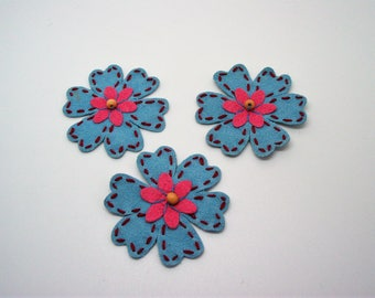 Clear set of 3 flowers in Blue Suede applications, in the Center Flower Pink suede with small wooden bead clear, Burgundy thread stitching
