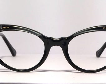 Vintage eyewear. Unique cat eye style. Made in France 1950's. Gloss black with a touch of blue and fabulous rhinestones! Excellent quality!