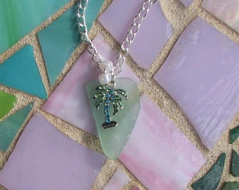 soft green sea glass necklace with palm tree charm