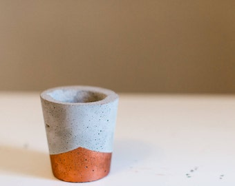 Concrete candle holder with copper accents