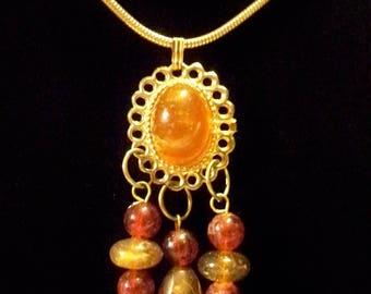 Gold Tone Amber beaded Pendant