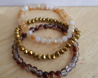3 Bangle Stretch Bracelets made with Gold Crystal Beads, Brown Crack Beads and Cream and Gold Glass Beads