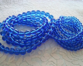 "6mm & 8mm Medium Cobalt Blue Rounds. Smooth Rounds in Translucent Royal Blue. Imitation Druk Beads. Full 16"" Strands. Saturated Color."