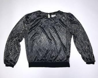 very cool black with metallic animal print 1980s polyester top by Clio