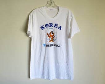Vintage 1988 Seoul Korea Summer Olympics mascot graphic t-shirt | N/A (tag size) Medium (fit) | DEADSTOCK