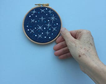 Embroidered winter snow fall hoop art
