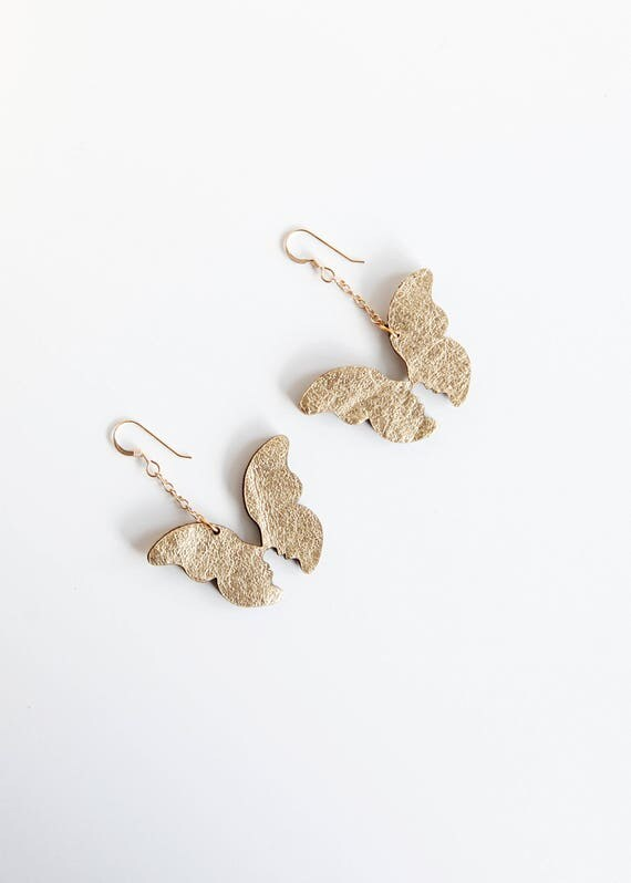 Gold butterfly dangle leather earrings- loving couple earrings- kissing faces in butterfly wings- gold leather earrings- statement earrings