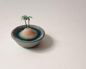 Tiny private island in a little concrete bowl, tiny beach, miniature landscape, tiny decor