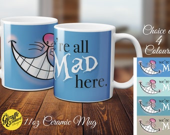 Alice in Wonderland Cheshire Cat Were All Mad here Novelty 11oz Coffee Gift Mug - 4 Colours - Blue-Duck Egg-Stone-Turquoise